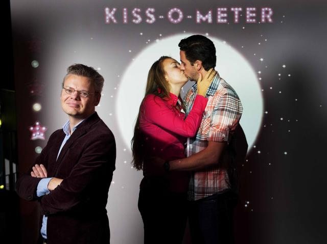 Remco Kort, author of the kissing study, stands near his Kiss-O-Meter developed for the Micropia museum (Huffington Post)