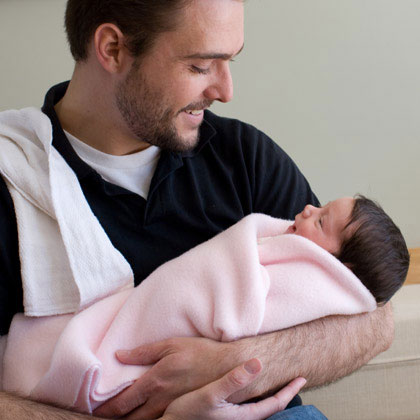 Dad with newborn baby (Babble)