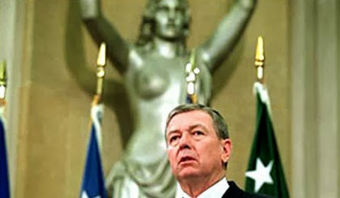 U.S. Attorney General John Ashcroft and Spirit of Justice statue, 2002 (Medieval POC Tumblr)