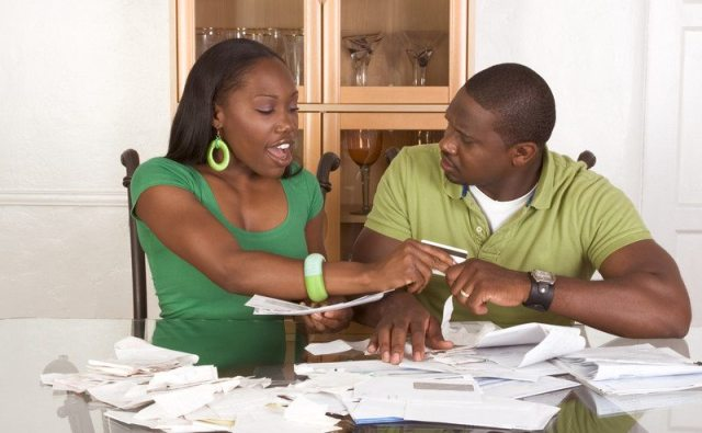 Couple with bills (Buzz Nigeria)